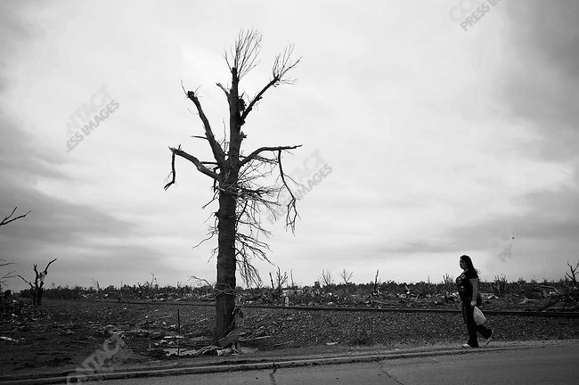 Much of Joplin is unrecognizable since the tornado. A woman walks by the railroad tracks near 20th St. May 24, 2011...