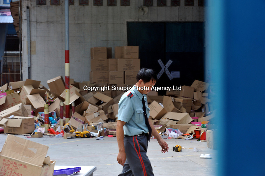 A security guard passes by the closed factory warehouse belonging to Smart Union, one of several factories in Zhang Mutou in South China that went bankrupt in the current credit crisis. Smart Union, that produced toys for Mattel amongst others, left 6,000 workers jobless and penniless after they could not pay the salaries. Hundreds of factories in South China are closing due to increased labor and material costs and the current credit crissis is exasperating. The problem leaving ghost towns behind. .24 Oct 2008