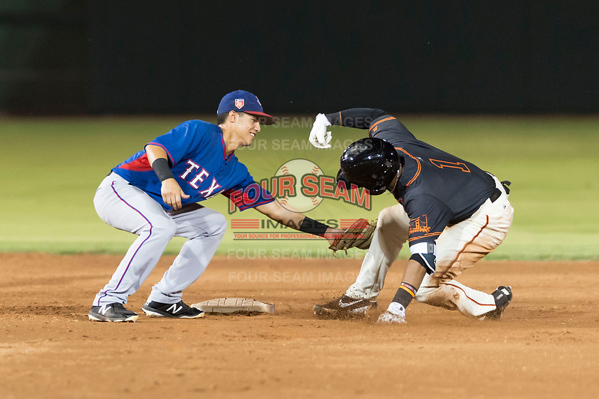 AZL Rangers second baseman Kenen Irizarry (19) applies the tag to Randy Norris (1) during an Arizona League game against the AZL Giants Black at Scottsdale Stadium on August 4, 2018 in Scottsdale, Arizona. The AZL Giants Black defeated the AZL Rangers by a score of 6-3 in the second game of a doubleheader. (Zachary Lucy/Four Seam Images)