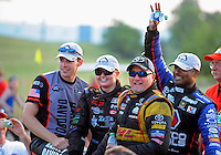 Jul. 1, 2012; Joliet, IL, USA: NHRA drivers (from left) pro stock motorcycle rider Andrew Hines , pro stock driver Erica Enders , funny car driver Jeff Arend and top fuel dragster driver Antron Brown celebrate after winning the Route 66 Nationals at Route 66 Raceway. Mandatory Credit: Mark J. Rebilas-