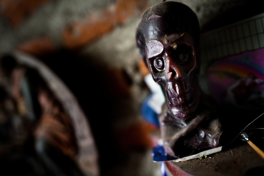 A skull sculpture is seen on the altar in a shaman's house in Cali, Colombia, 17 April 2013. Although the original spiritual tradition, kept by the indigenous shamen in Americas for centuries, has been systematically repressed by the Catholic Church, nowadays, more and more people from the urban areas of Latin America discover their roots and consult their everyday problems with esoteric practitioners, healers and shamen. Traditional indigenous rituals (reading of tobacco - interpretation of signs shown by burn tobacco leaves) have merged with European concepts (divination using playing cards) and animistic religious beliefs (worshipping the spirits) brought to Americas by the African slaves, keeping the spirituality in modern Latin American society alive.