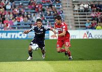 New England midfielder Ryan Guy (13) battles for the ball with Chicago defender Gonzalo Segares (13).  The Chicago Fire defeated the New England Revolution 3-2 at Toyota Park in Bridgeview, IL on Sept. 25, 2011.