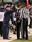 Nevada Head Coach Brian Polian talks to referees during the second half of an NCAA college football game against Fresno State in Reno, Nev., on Saturday, Nov. 22, 2014. (AP Photo/Cathleen Allison)