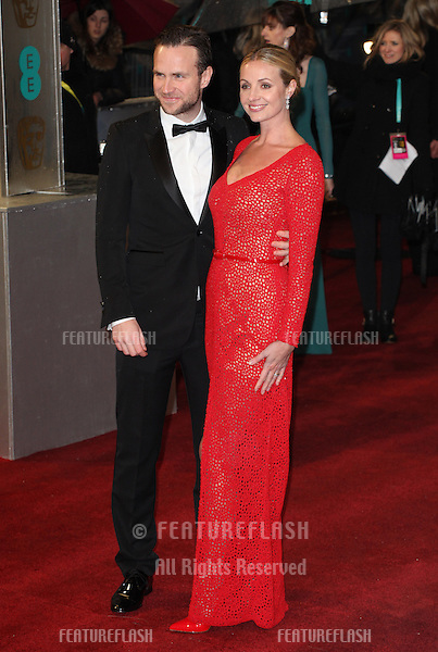 Rafe Spall and Elize Du Toit  arriving for the 2013 British Academy Film Awards, at the Royal Opera House, London. 10/02/2013 Picture by: Alexandra Glen / Featureflash