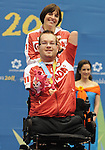 November 16 2011 - Guadalajara, Mexico:  Josh Vandervies waves to his Canadian fans with his assistant Dalia Mykolaiteine behind him after receiving his Bronze Medal in Boccia BC4 in the Multipurpose Gymnasium Revolución at the 2011 Parapan American Games in Guadalajara, Mexico.  Photos: Matthew Murnaghan/Canadian Paralympic Committee