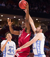 NWA Democrat-Gazette/J.T. WAMPLER Arkansas' Manuale Watkins tries for a rebound between North Carolina's Justin Jackson (44) and Luke May Sunday March 19, 2017 during the second round of the NCAA Tournament at the Bon Secours Wellness Arena in Greenville, South Carolina. The Tar Heels beat the Razorbacks 72-65 eliminating them from the tournament.