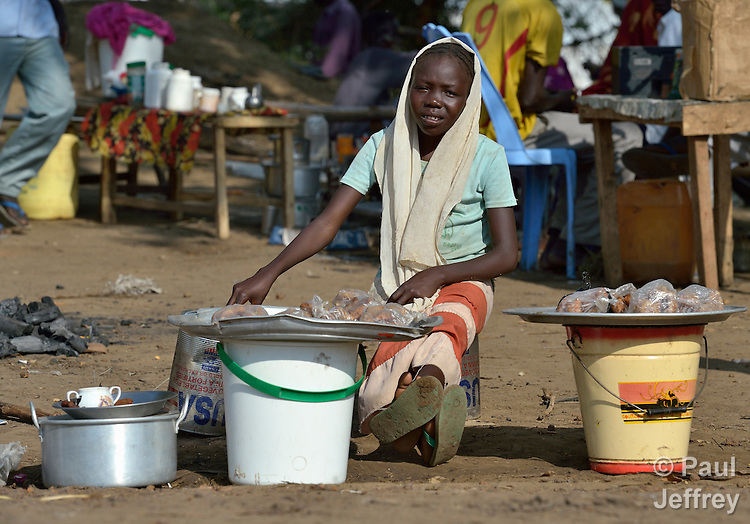 A girl sells food in the market in the Gendrassa refugee camp in South Sudan's Upper Nile State. More than 110,000 refugees were living in four camps in Maban County in October 2012, but officials expected more would arrive once the rainy season ended and people could cross rivers that block the routes from Sudan's Blue Nile area, where Sudanese military has been bombing civilian populations as part of its response to a local insurgency. Conditions in the camps are often grim, with outbreaks of diseases such as Hepatitis E.