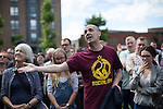 © Joel Goodman - 07973 332324 . 30/07/2016 . Liverpool , UK . A member of the crowd remonstrates with Owen Smtih at an Owen Smith rally in a field off Bridgewater Street in Liverpool . The booked venue , the Camp and Furnace warehouse , reportedly cancelled the booking . Smith is campaigning to replace Jeremy Corbyn as the leader of the Labour Party . Photo credit : Joel Goodman