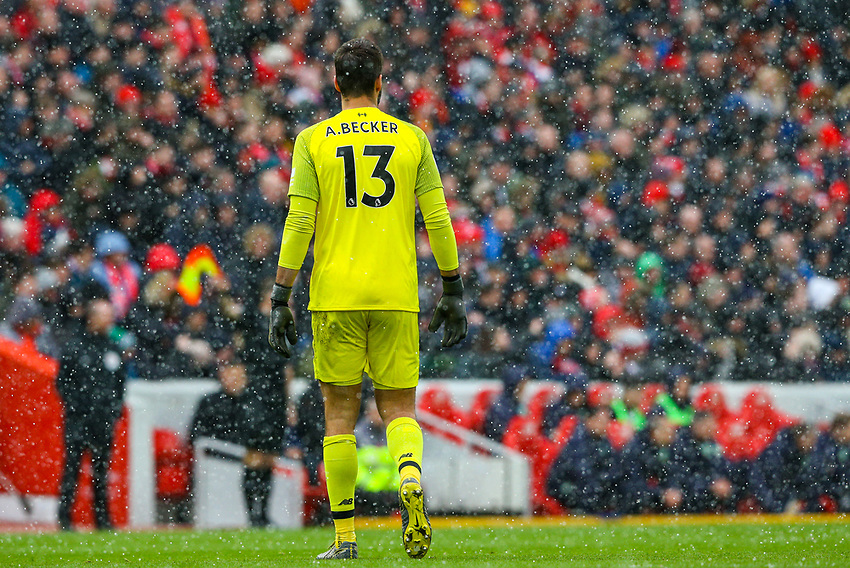 Liverpool's Alisson Becker in action as hail falls on Anfield<br /> <br /> Photographer Alex Dodd/CameraSport<br /> <br /> The Premier League - Liverpool v Burnley - Sunday 10th March 2019 - Anfield - Liverpool<br /> <br /> World Copyright © 2019 CameraSport. All rights reserved. 43 Linden Ave. Countesthorpe. Leicester. England. LE8 5PG - Tel: +44 (0) 116 277 4147 - admin@camerasport.com - www.camerasport.com