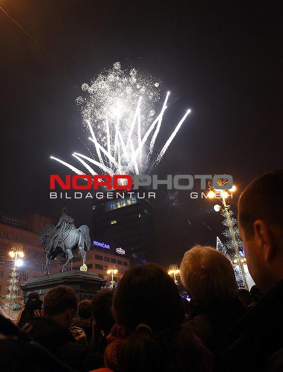31.12.2013., Zagreb,Croatia  - New Year celebrations .Fireworks over Zagreb on the main square.<br /> <br /> Foto &not;&copy;  nph / PIXSELL / Zeljko Lukunic