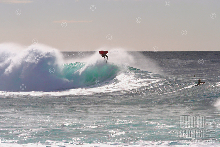 Spencer Skipper throws an air forward out of the pocket at Pipeline on Oahu's North Shore.