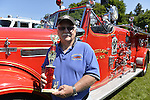 Old Westbury, New York, United States. 7th June 2015. Ex-Chief NIEL HICKS is holding the trophy the Manhasset-Lakeville Fire Dept. Truck won in the fire truck category at the 50th Annual Spring Meet Car Show sponsored by Greater New York Region Antique Automobile Club of America. Over 1,000 antique, classic, and custom cars participated at the popular Long Island vintage car show held at historic Old Westbury Gardens.
