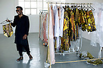 JOHANNESBURG, SOUTH AFRICA OCTOBER 30: South African designer David Tlale shows a garment from his latest collection in his studio at Mercedes Benz Africa fashion week Africa on October 30, 2014 held at Melrose Arch in Johannesburg, South Africa. Designers from all over Africa showed their best collections at the yearly event. David Tlale is the most known South African designer and he has shown back to back at New York fashion week. (Photo by: Per-Anders Pettersson)