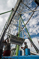 NWA Democrat-Gazette/ANTHONY REYES &bull; @NWATONYR<br /> James Carney, from left, Thomas McGrady, and Casey Denton, all with Pride Amusements of Joplin, assemble the seats for the ferris wheel Monday, Sept. 28, 2015 for the Fall Carnival at Parsons Stadium in Springdale. Preperations for the carnival included setting up the rides, games and other boothes. The carnival begins Wednesday at 6 p.m. and continues until Oct. 4.