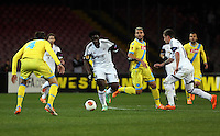 Thursday 27 February 2014<br /> Pictured: Wilfried Bony of Swansea (C) against Henrique of Napoli (L). <br /> Re: UEFA Europa League, SSC Napoli v Swansea City FC at Stadio San Paolo, Naples, Italy.