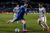 7th March 2020; Coliseum Alfonso Perez, Madrid, Spain; La Liga Football, Club Getafe Club de Futbol versus Celta Vigo; Jorge Molina (Getafe CF) challenges Lucas Olaza (Celta de Vigo)