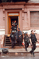 NYPD ESU officers remove squatters from a building in the East Village in New York on May 28, 1995.(© Richard B. Levine)