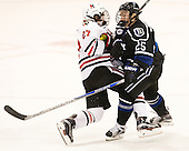 Dalen Hedges (NU - 27), Cody DePourcq (Bentley - 25) - The visiting Bentley University Falcons defeated the Northeastern University Huskies 3-2 on Friday, October 16, 2015, at Matthews Arena in Boston, Massachusetts.