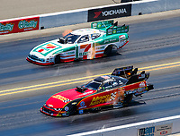 Jul 30, 2017; Sonoma, CA, USA; NHRA funny car driver Courtney Force (near) races alongside Jim Campbell during the Sonoma Nationals at Sonoma Raceway. Mandatory Credit: Mark J. Rebilas-USA TODAY Sports