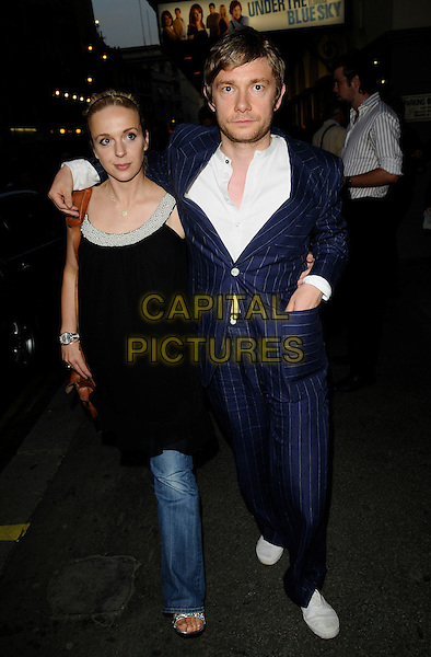 "GUEST & MARTIN FREEMAN .At the ""Under The Blue Sky"" Press Night,.Duke of York's Theatre, London, England, July 25th 2008..full length blue pinstripe suit sunglasses white shirt shoes.CAP/CAN.©Can Nguyen/Capital Pictures"