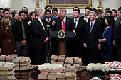 United States President Donald J. Trump speaks behind a table full of McDonald's hamburgers, Chick fil-a sandwiches and some other fast food as he welcomes the 2018 Division I FCS National Champions: The North Dakota State Bison in the State Dining Room of the White House on March 4, 2019 in Washington, DC.<br /> Credit: Oliver Contreras / Pool via CNP