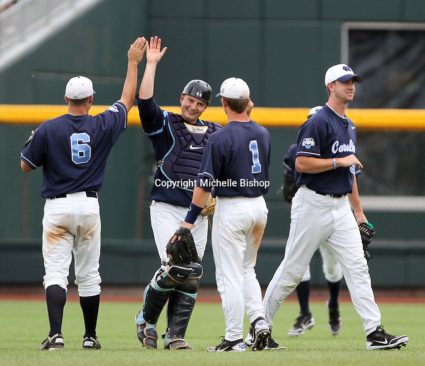 North Carolina's Levi Michael (6), Chase Jones (41), Tommy Coyle (1) and Chris Munnelly (37) celebrate UNC's 3-0 elimination win over Texas at the 2011 College World Series in Omaha, Neb. (Photo by Michelle Bishop)..