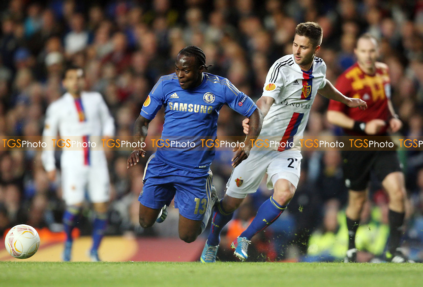 Victor Moses of Chelsea and Markus Steinhofer of Basel - Chelsea vs Basel, UEFA Europa League Semi-Final 2nd Leg at Stamford Bridge, Chelsea - 02/05/13 - MANDATORY CREDIT: Rob Newell/TGSPHOTO - Self billing applies where appropriate - 0845 094 6026 - contact@tgsphoto.co.uk - NO UNPAID USE.