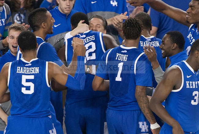 UK head coach John Calipari hugs Kentucky Wildcats forward Alex Poythress (22) during the NCAA Final Four vs. Wisconsin at the AT&T in Arlington, Tx., on Saturday, April 5, 2014. Photo by Eleanor Hasken | Staff