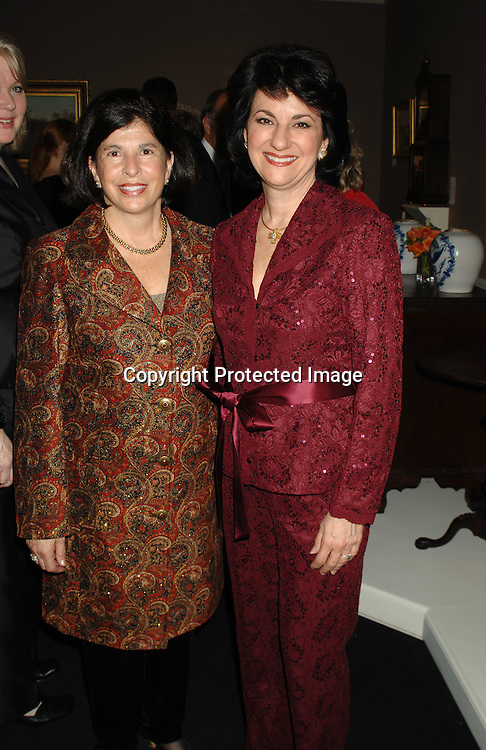 Mary Easley on right and sister Judy ..arriving at The 53rd Annual Winter Antiques Show on ..January 18, 2007 at The Seventh Regiment Armory. ..The proceeds benefit East Side House Settlement of the South Bronx. ..Robin Platzer, Twin Images
