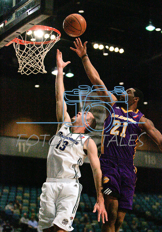 Los Angeles D-Fenders Orien Greene tries to block a shot by Blake Ahearn of the Reno Bighorns during the men's basketball game in Reno, Nev., on Friday, Jan. 6, 2012. The D-Fenders won 109-78..Photo by Cathleen Allison