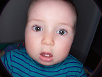 humorous wide angle portrait of wide-eyed toddler with two large teeth [limited file size available]