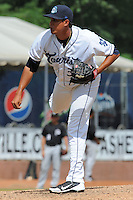 Asheville Tourists  pitcher Rafael Suarez #31 delivers a pitch during a game against the Savannah Sand Gnats at McCormick Field on August 5, 2012 in Asheville, North Carolina. The Tourists defeated the Sand Gnats 5-4. (Tony Farlow/Four Seam Images).