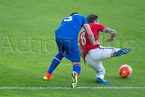 01.06.2016  Ullevaal Stadion, Oslo, Norway.L-R  Haukur Heioar Hauksson of Iceland brings down Stefan Johansen of Norway during the International Football Friendly match between Norway and Iceland at the Ullevaal Stadion in Oslo, Norway.