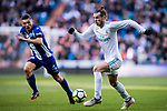 Gareth Bale (R) of Real Madrid is followed by Daniel Alejandro Torres Rojas, D Torres, of Deportivo Alaves during the La Liga 2017-18 match between Real Madrid and Deportivo Alaves at Santiago Bernabeu Stadium on February 24 2018 in Madrid, Spain. Photo by Diego Souto / Power Sport Images