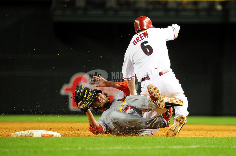 Apr. 12, 2011; Phoenix, AZ, USA; Arizona Diamondbacks base runner (6) Stephen Drew collides with St. Louis Cardinals pitcher (56) Brian Tallet in the fifth inning at Chase Field. Mandatory Credit: Mark J. Rebilas-