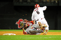 Apr. 12, 2011; Phoenix, AZ, USA; Arizona Diamondbacks base runner (6) Stephen Drew collides with St. Louis Cardinals pitcher (56) Brian Tallet in the fifth inning at Chase Field. Mandatory Credit: Mark J. Rebilas-