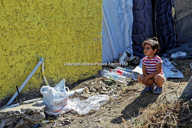 Pictured: A young girl rests on one of the paths in the camp.<br /> Re: Everyday life at the Moria refugee camp on the island of Lesbos, Greece.