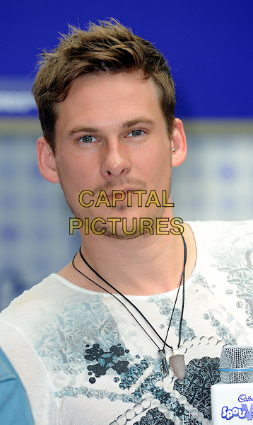 LEE RYAN of BLUE .Blue at the Cadburys Spots and Stripes Toilet Roll Challenge at Westfield Shopping Centre, London, England, UK,16th April 2011..portrait headshot facial hair necklaces white grey gray t-shirt .CAP/WIZ.© Wizard/Capital Pictures.