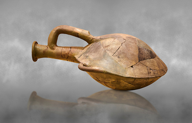 Hittite terra cotta water bottle carried by straps on the back. Hittite Old Period, 1650 - 1450 BC. Huseyindede. Çorum Archaeological Museum, Corum, Turkey. Against a grey bacground.