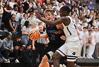 Fayetteville guard Corey Williams, Jr (12) drives the ball down the court during a basketball game, Friday, January 10, 2020 at Fayetteville High School in Fayetteville. Check out nwaonline.com/200111Daily/ for today's photo gallery.<br /> (NWA Democrat-Gazette/Charlie Kaijo)