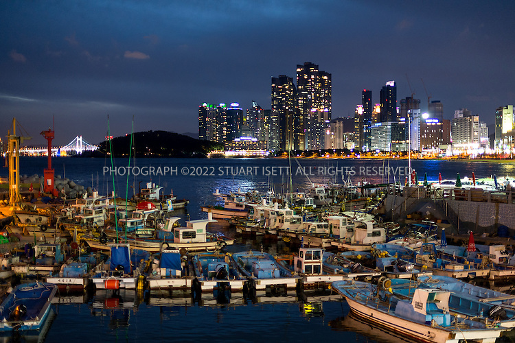 9/5/2013--Busan, South Korea<br /> <br /> Fishing boats moared in Mipo Harbor next to Haeundae Beach in Busan (Pusan).<br /> <br /> Photograph by Stuart Isett<br /> &copy;2013 Stuart Isett. All rights reserved.
