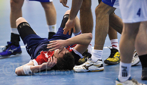 02 NOV 2011 - LONDON, GBR - Britain's Chris Mohr (in blue and red) recovers after a challenge during the Men's 2013 World Handball Championship qualification match against Israel at the National Sports Centre at Crystal Palace (PHOTO (C) NIGEL FARROW)