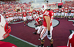 Wisconsin Badgers huddle up prior to the NCAA college football game against the Ohio State Buckeyes on October 16, 2010 at Camp Randall Stadium in Madison, Wisconsin. The Badgers beat the Buckeyes 31-18. (Photo by David Stluka)