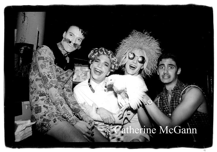 "April 1991: L-R: Club Kids Ernie Glam, MIchael Alig (curly blonde wig),  James St. James (in sunglasses) and friend (holding a chicken) pose for a photo at a party for actress Donna Douglas, best known for portraying Ellie May Clampett on ""The Beverly Hillbillies"" TV show,  at Limelight nightclub  in New York City, New York. (Copyright 2010 Catherine McGann/ All Rights Reserved)."