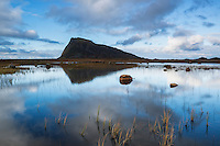 Hoven mountain peak rises from marshland of Gimsøya, Lofoten Islands, Norway