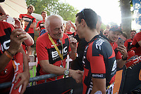 Richie Porte (AUS/BMC) checks in with team owner Andy Rhis (and his VIP guests) after the stage on the Champs-Elysées is finished<br /> <br /> Final stage 21 - Chantilly › Paris/Champs Elysées (113km)<br /> 103rd Tour de France 2016