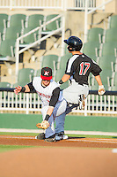Kannapolis Intimidators first baseman Danny Hayes (32) stretches for a throw as Evan Van Hoosier (17) of the Hickory Crawdads hits the bag at CMC-Northeast Stadium on May 5, 2014 in Kannapolis, North Carolina.  The Intimidators defeated the Crawdads 5-2.  (Brian Westerholt/Four Seam Images)