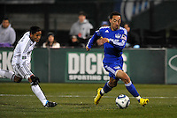 Ryan Smith (blue). Andy Najar (white)...Kansas City Wizards defeated DC United 4-0 in their season opener, at Community America Ballpark in Kansas City, Kansas.