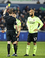 Referee John Brooks shows a yellow card to George Baldock of Sheffield United during the Sky Bet Championship match between Swansea City and Sheffield United at the Liberty Stadium, Swansea, Wales, UK. Saturday 19 January 2019