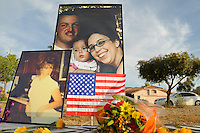"Gilbert, Arizona – Friends and family of the Mederos Family gathered to hold a memorial for the four victims of the Gilbert Massacre occurred on May 2, 2012. According to Gilbert Police, Lisa Mederos, Amber Mederos, baby Lilly Mederos, and Jim Hiott (Amber's fiancé) were all killed by notorious white supremacist and Neo-Nazi Jason ""J.T."" Ready before taking his own life. In this image, enlarged photographs of the four victims of the Gilbert massacre rise above a table with flowers at the memorial service. Photo by Eduardo Barraza © 2012"